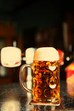 Beer glass on a bar table. Closeup Stock Photography
