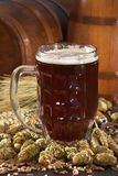 Beer glass. Beer barrels, hops, wheat, grain, barley and malt Stock Image