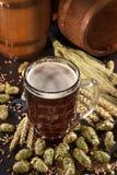 Beer glass. Beer barrels, hops, wheat, grain, barley and malt Stock Photos