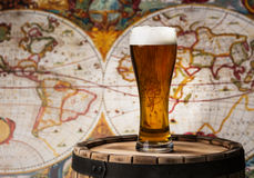 Beer glass of beer. On a wooden barrel Stock Photos