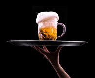 Beer into glass on a black Royalty Free Stock Photography