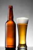 Beer in glass and bottle Royalty Free Stock Photo