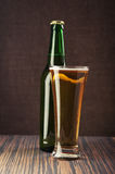 Beer glass and bottle Stock Photography