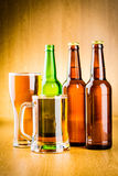 Beer glass and bottle Stock Photos