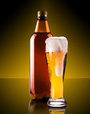 Beer in glass and bottle Royalty Free Stock Photography