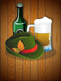 Beer glass, bottle and  German Oktoberfest hat Stock Photos