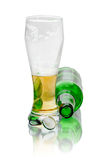Beer glass and a bottle lying Royalty Free Stock Photos