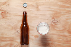 Beer glass and bottle on wood Royalty Free Stock Photo