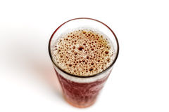 Beer Glass Bubbling Froth top view Stock Photo
