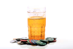 Beer glass and casino chips Royalty Free Stock Photos
