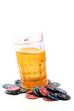 Beer glass and casino chips Royalty Free Stock Photography