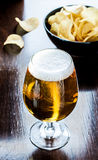 Beer glass and chips - snack bar or pub menu Stock Images