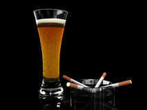 Beer in glass and cigarettes Royalty Free Stock Photo