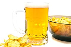 Beer in glass and crispy chips Stock Images