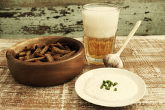 Beer in a glass, croutons and garlick sauce. Beer and snack to beer. Royalty Free Stock Photos