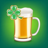 Beer glass cup with four leaf clover Royalty Free Stock Photos