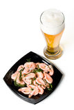 Beer in a glass and a dish with shrimps Royalty Free Stock Photography