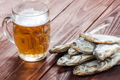 Beer glass and dried fish. Stock Image