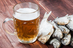 Beer glass and dried fish. Royalty Free Stock Photos