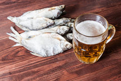 Beer glass and dried fish. Royalty Free Stock Images