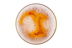Beer in glass with foam. Beer in glass. Beer foam. View from above stock images