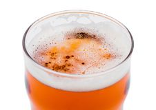 Beer in glass with foam. View from above on white Stock Image