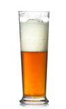 Beer glass full of cold lager. Royalty Free Stock Photography