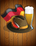 Beer glass, German flag and  Oktoberfest hat Stock Photo