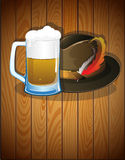 Beer glass, and  German Oktoberfest hat Royalty Free Stock Photography