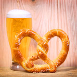 Beer Glass with German Pretzel on wooden Stock Photography