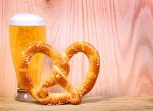 Beer Glass with German Pretzel on wooden background. Beer Glass with German Pretzel on wooden Stock Image