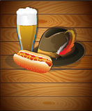 Beer glass, hot dog and  Oktoberfest hat Royalty Free Stock Images