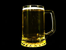 Beer glass isolated. Half pint glass of beer isolated against a black background Royalty Free Stock Photos