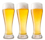 Beer into glass isolated on white Stock Photo