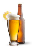 Beer in glass with lemon and bottle Stock Image
