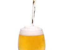 Beer glass of light beer stream with a foam. On a white background Stock Photography