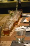 Beer Glass Lined on table. Beer glass lined on wood table, beer, glass, glass beverages, spoon Royalty Free Stock Photos