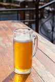 Beer glass on a little table of cafe Royalty Free Stock Photography