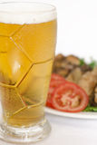 Beer. Glass of beer and meat Stock Photos