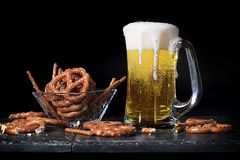 Beer in Glass Mug with Pretzels Stock Image