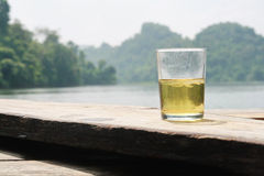 Beer glass and natural lake mountain view Royalty Free Stock Photo
