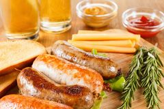 Beer glass pint with pretzels and grilled sausages. October fest, traditional menu, Beer glass pint with grilled chicken sausage with ketchup, mustard and stock photo