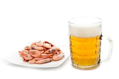 Beer in glass and prawns Stock Image