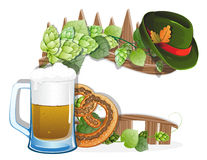 Beer glass, pretzel and  German hat. With oak leaves on a wooden fence. Abstract Oktoberfest background Royalty Free Stock Image