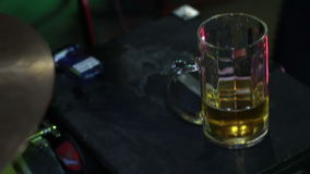 Beer Glass in a Pub. Half drunk glass of beer with an out of focus pub background stock video