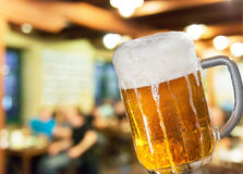 Beer glass in pub Royalty Free Stock Photography