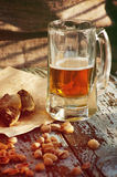 Beer in a glass, salty fish and pistachios. Beer and beer snack. Royalty Free Stock Images