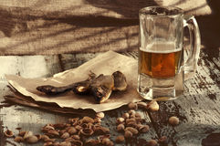 Beer in a glass, salty fish and pistachios. Beer and beer snack. Royalty Free Stock Photography