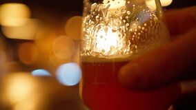 Beer glass on table in bar