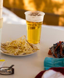Beer in a glass on a table in a cafe Royalty Free Stock Photo